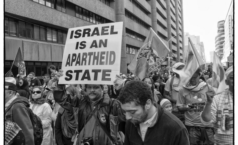 """""""Israel-Palestine protest march, Cape Town"""" by Louis George 2011 is licensed with CC BY-NC-ND 2.0. To view a copy of this license, visit https://creativecommons.org/licenses/by-nc-nd/2.0/"""